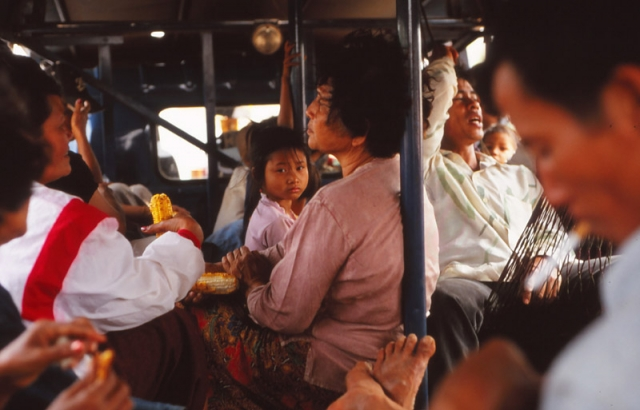 Scene inside a crowded bus in southern Laos