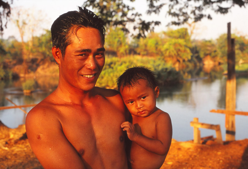 Father and child after a bath in the Mekong River, Don Det Island