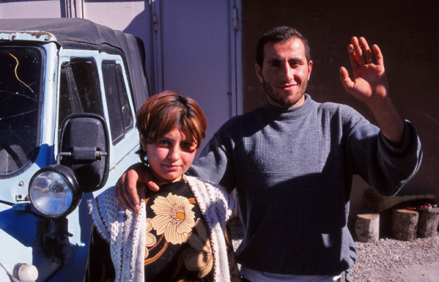 David, a farmer, with his wife and six-month-old son at their home near Lake Sevan
