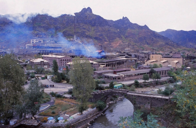 A bridge built by Queen Tamar in the 12th century is dwarfed by a polluting copper smelter at Alaverdi