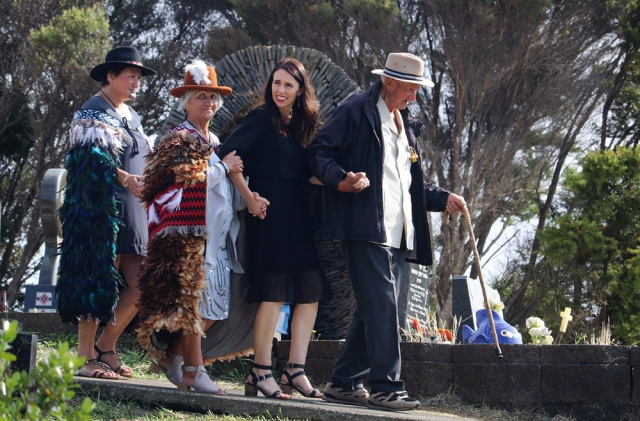 February: Prime Minister Jacinda Ardern is escorted to the grave of land rights leader Dame Whina Cooper by her daughter Hine Puru and son Joe Cooper during a visit to Panguru. Photo: Peter de Graaf