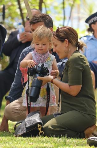 February: Budding photojournalist Neve Ardern Gayford, daughter of Prime Minister Jacinda Ardern, checks out a camera at Waitangi. Photo: Peter de Graaf