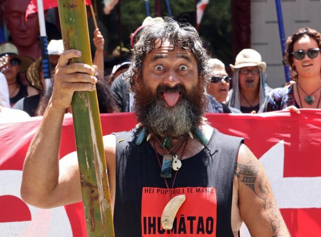 February: Buck Cullen leads the Waitangi Day hīkoi to the Treaty Grounds. Photo: Peter de Graaf