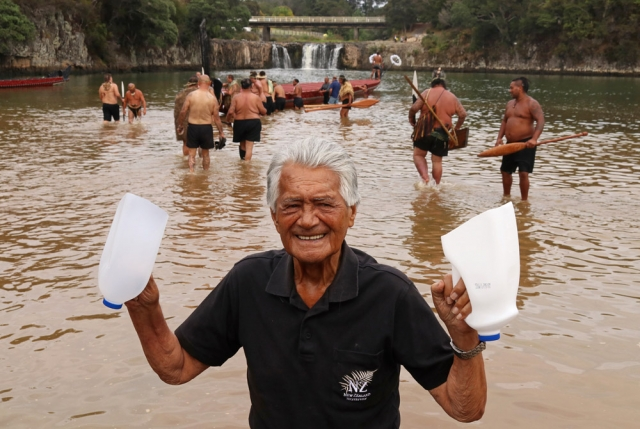 February: Eru Patuone Heperi, 92, the only surviving crew member from Ngātokimatawhaorua's first journey in 1940, prepares to board the great waka with a pair of bailers. Photo: Peter de Graaf