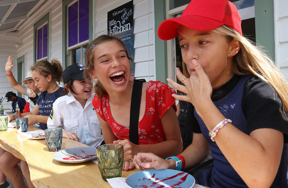 March: Kids compete in the donut-eating competition at Mangonui's Waterfront Festival. Photo: Peter de Graaf