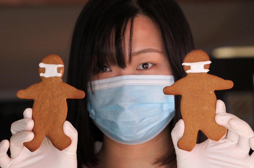 April: Barista Shujing Piao with coronavirus-themed gingerbread men at Kerikeri's Café Cinema. Photo: Peter de Graaf
