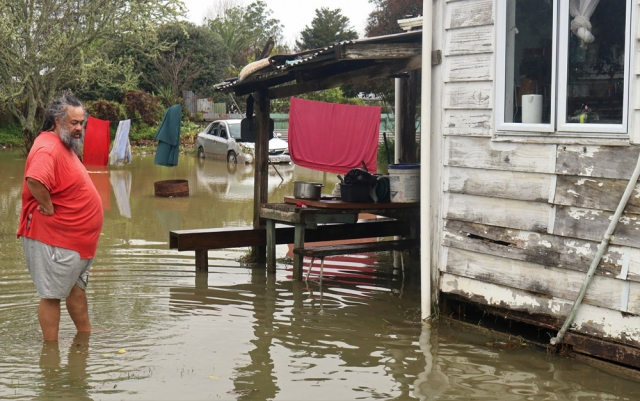 July: Skip Kidwell surveys the flooding around his home, the worst-hit property on the worst-hit street in Moerewa. Photo: Peter de Graaf