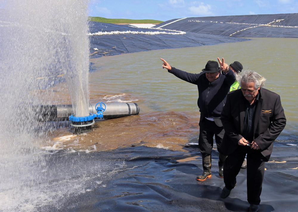 September: Infrastructure Minister Shane Jones and Te Rarawa chairman Haami Piripi turn on the tap for Tupehau water reservoir near Ahipara. Photo: Peter de Graaf