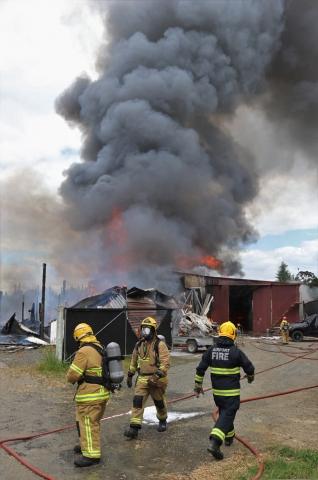 November: An industrial shed is engulfed by flames near Kerikeri. Photo: Peter de Graaf