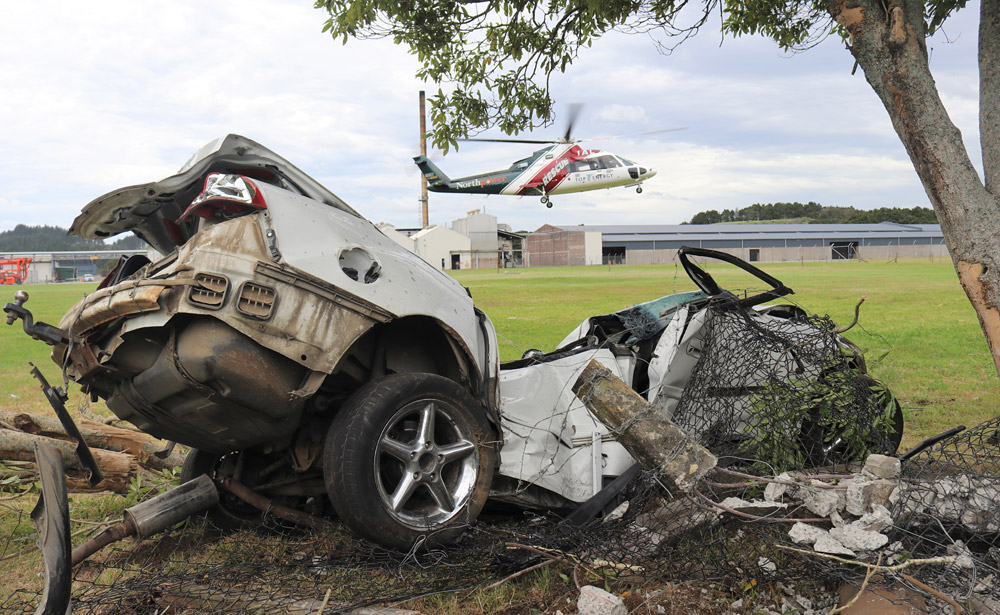 November: The Northland Rescue Helicopter lifts off with an injured driver who crashed after allegedly kidnapping a man and forcing him to withdraw money from a Paihia bank. Photo: Peter de Graaf
