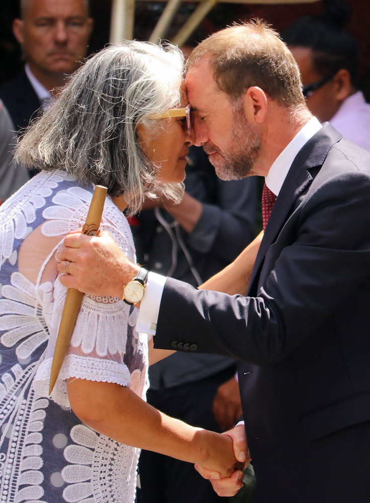 February: Ngāpuhi chairwoman Mere Mangu congratulates an emotional Treaty Negotiations Minister Andrew Little for delivering a speech entirely in te reo Māori. Photo: Peter de Graaf