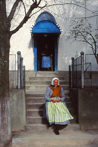 A woman leaves church in Rovensko