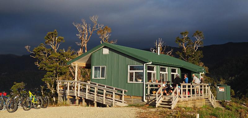 Riders relax at the 20-bunk Pororari Hut