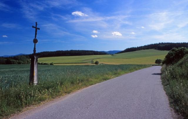 Landscape with roadside cross in the Šumava Mountains, South Bohemia