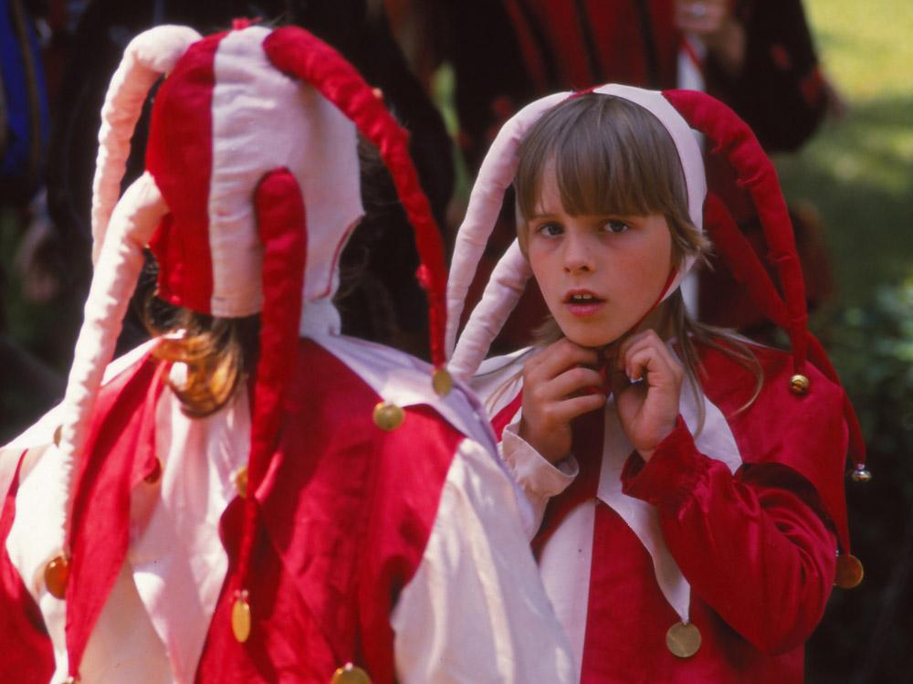 Children dress as jesters during the Festival of the Five-Petalled Rose, Český Krumlov