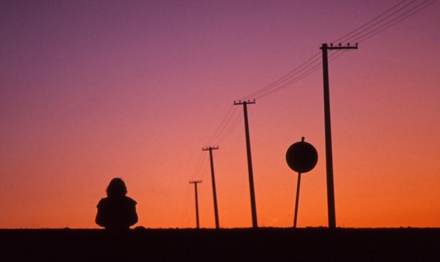 A girl is silhouetted during a sunset walk near České Budějovice