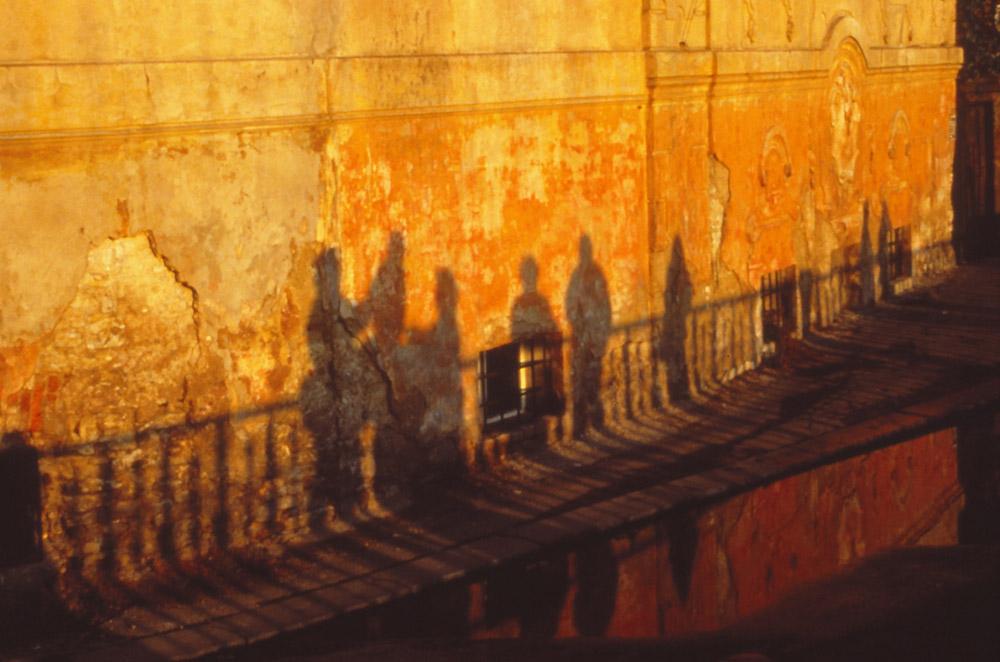 Late afternoon sun casts shadows near the Vltava River, Prague.