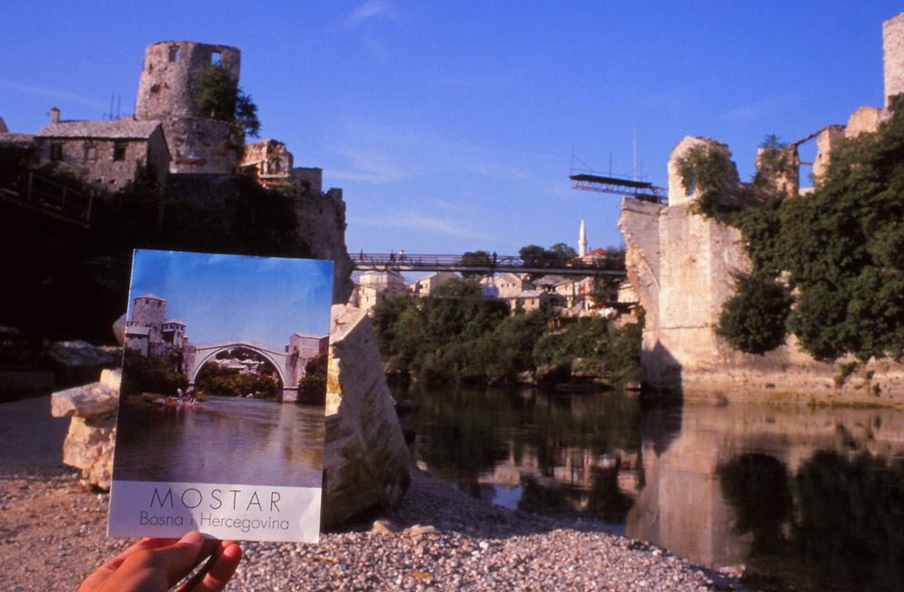 Bosnia, 1999: Ruins of the 16th century Stari Most (Old Bridge) and a tourist brochure showing how it used to look. It was rebuilt in 2004
