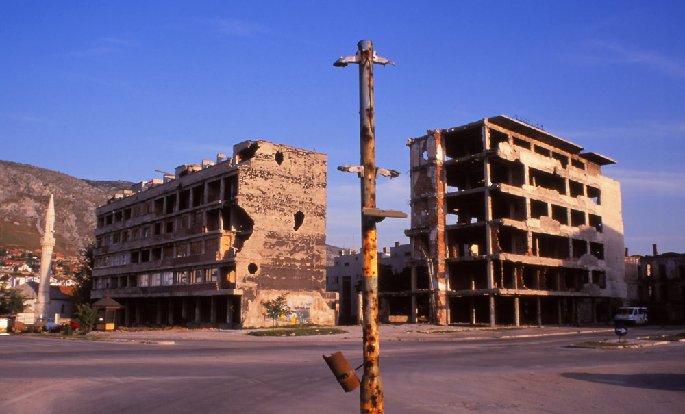 Bosnia, 1999: War-damaged traffic lights and apartment buildings in central Mostar