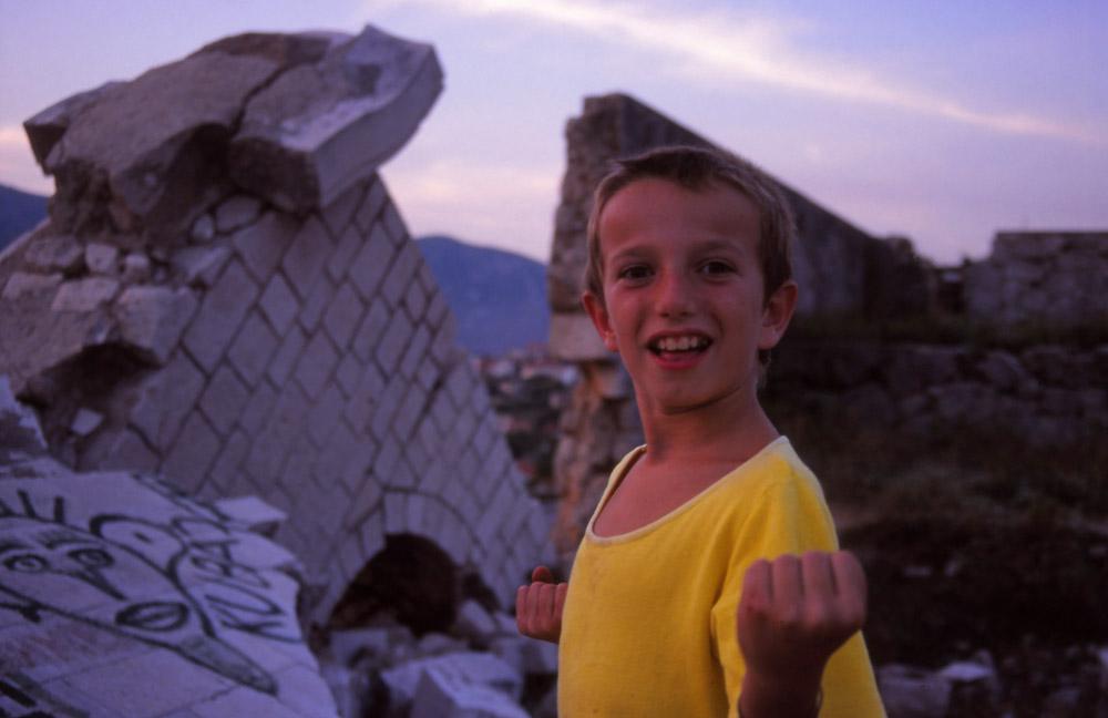 Bosnia, 1999: A Bosnian boy plays in the ruins of Mostar