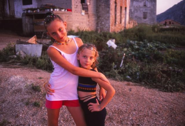 Bosnia, 1999: Girls play in a war-damaged quarter of Mostar