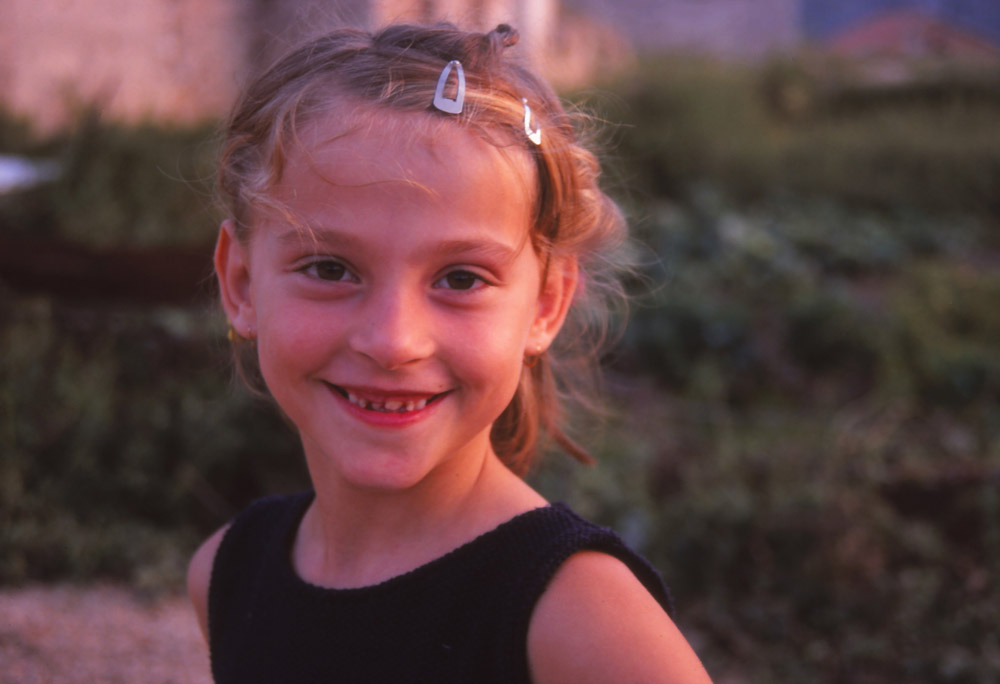 Bosnia, 1999: A Bosnian girl poses for the camera in Mostar