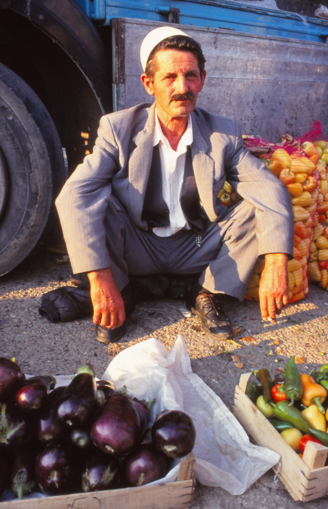 Kosovo, 1997: A trader in the market of Peja, Kosovo's second city, wearing the traditional Albanian fez