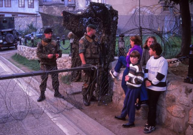 Kosovo, 1999: Girls talk to German peacekeepers in Prizren