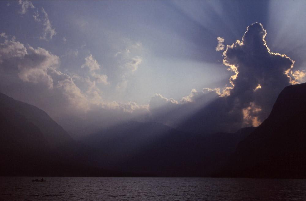 Slovenia, 1994: Sunburst over Lake Bohinj in the Julian Alps
