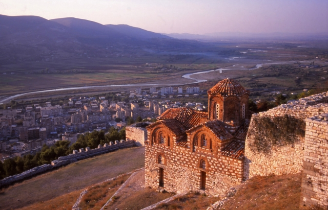The 14th century Church of the Holy Trinity overlooks modern suburbs and the meandering River Osum in Berat