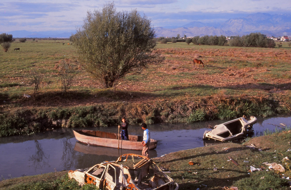 Youngsters find a scenic spot for a boat ride on the outskirts of Shkodra
