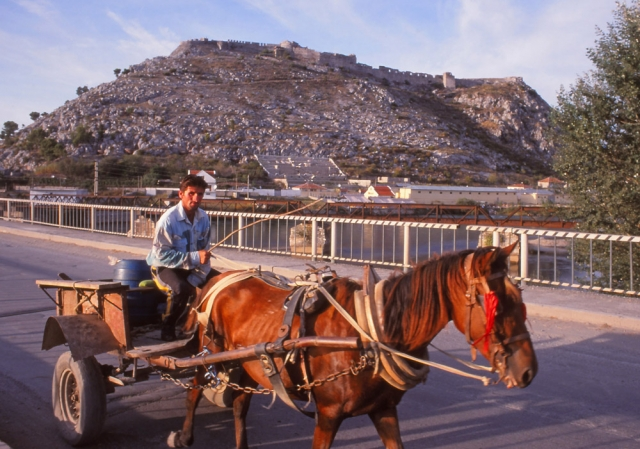 Horse-powered transport in Shokdra with Rozafa Castle in the distance