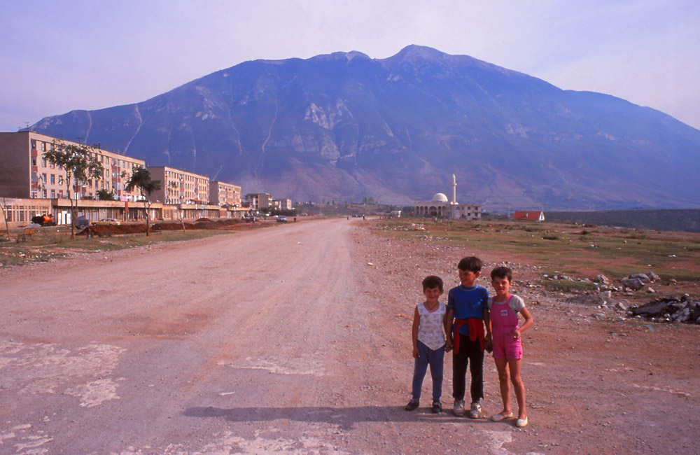The main street of Kukës, near the Kosovo border, with 2500m-high Mt Gjallica in the distance