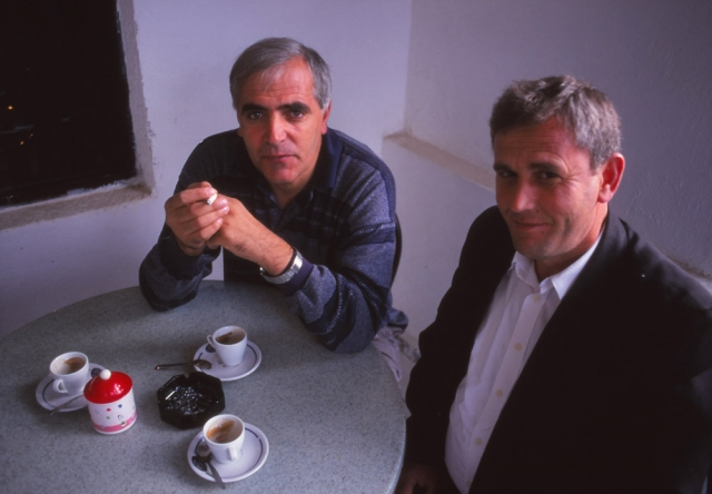 Writer Petrit Palushi, left, and friend at a cafe in Kukës
