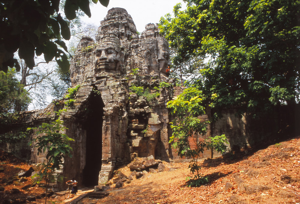An enigmatic face gazes from the western gate of Angkor Thom, the 12th century capital of the Khmer Empire