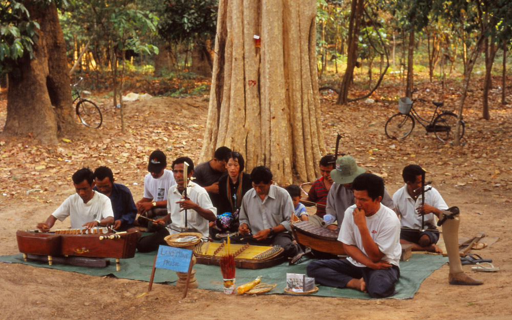 """An amputee orchesta plays """"landmine music"""" at Banteay Srei. Decades of conflict have left Cambodia with one of the world's highest rates of limb amputation"""
