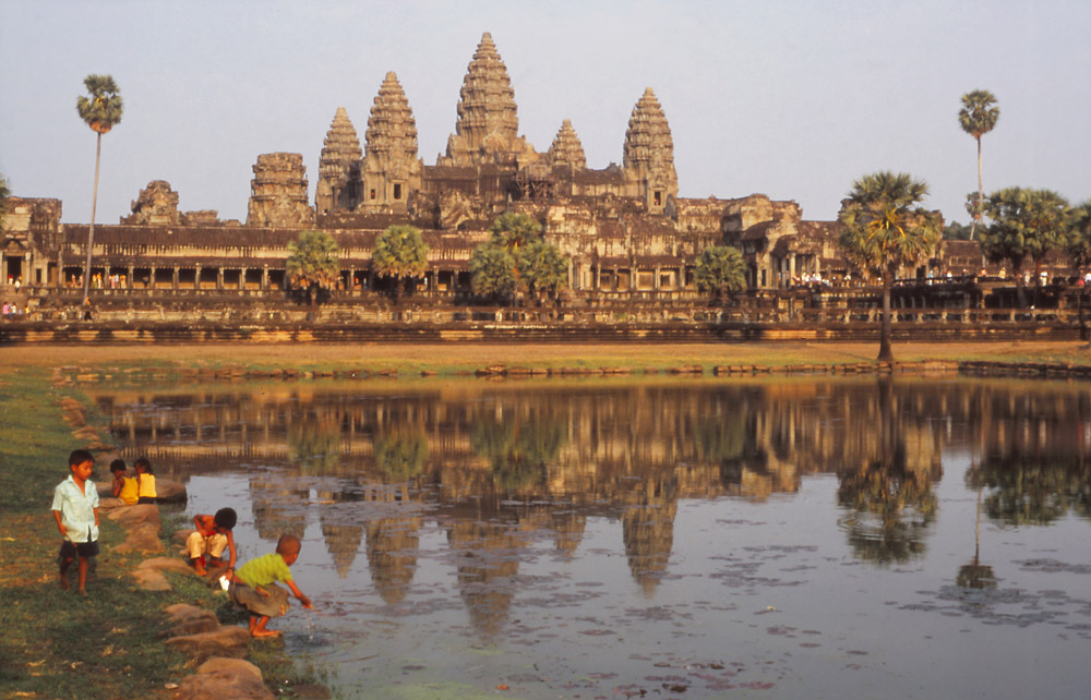 Children play in a ceremonial pool at Angkor Wat, still the world's biggest religious structure