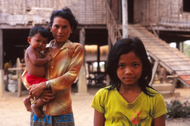A family outside their home near Battambang in rural Cambodia